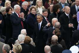FILE -- Outgoing President Barack Obama and Vice President Joe Biden before the start of Donald Trump's inauguration as the nation�s 45th president at the U.S. Capitol in Washington, Jan. 20, 2017. Fast forward to April 2017, Obama�s extended post-presidential vacation is about to end. After spending weeks in French Polynesia � including time on the yacht of the movie mogul David Geffen along with Bruce Springsteen, Tom Hanks and Oprah Winfrey � Obama will return to Chicago on April 24 for his first public event as a former president. (Josh Haner/The New York Times)