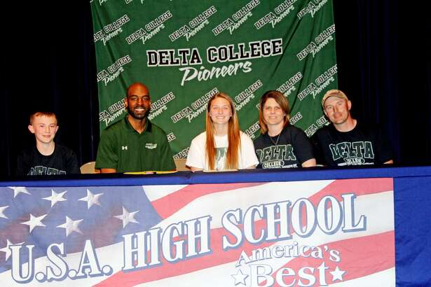 USA's Marisa Morton recently signed to play basketball for Delta college pictured with Morton from left: brother Nash Morton, Delta College assistant coach Jason Brown, mother Rachel Morton and father Craig Morton.
