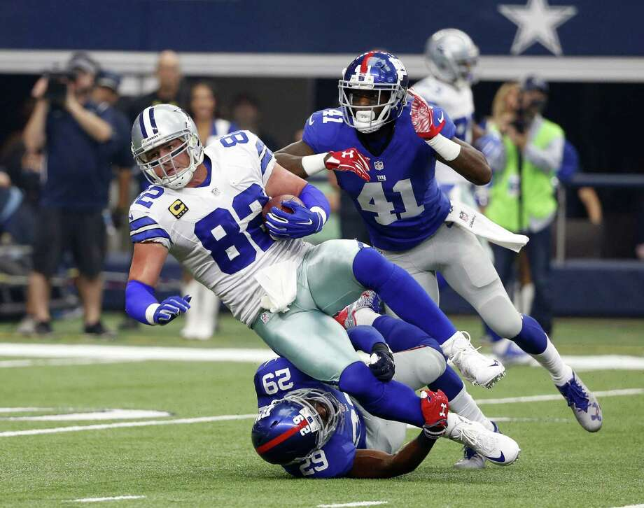 In this Sept. 11, 2016, file photo, Dallas Cowboys tight end Jason Witten (82) is tackled after a catch by New York Giants free safety Nat Berhe (29) and cornerback Dominique Rodgers-Cromartie (41) during an NFL football game in Arlington, Texas. The Giants and Cowboys will face off Sept. 10 at the Cowboys' AT&T Stadium, in NBC Sports' opening Sunday Night Football broadcast of the 2017 season. Photo: Michael Ainsworth / Associated Press / FR171389 AP