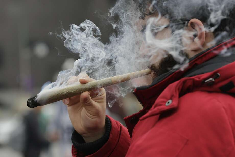 A resident smokes a large marijuana joint during the 420 Day festival on the lawns of Parliament Hill in Ottawa, Ontario, Canada, on Thursday, April 20, 2017. Canada is planning to legalize�recreational marijuana, which would make it only the second nation to do so,�after Uruguay. Photographer: David Kawai/Bloomberg Photo: David Kawai, Bloomberg