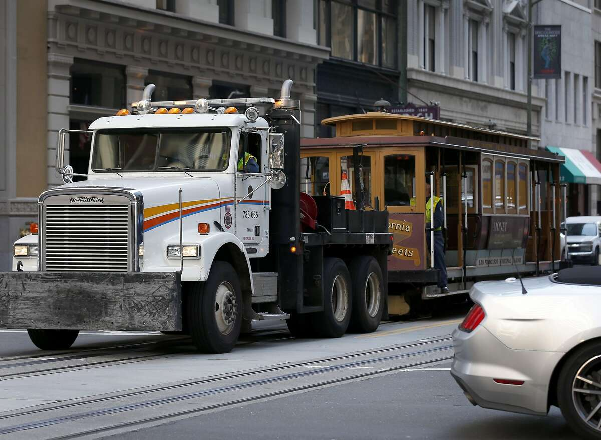 A California Street cable car is towed back to the car barn after a massive power outage affected a widespread area of the city in San Francisco, Calif. on Friday, April 21, 2017.