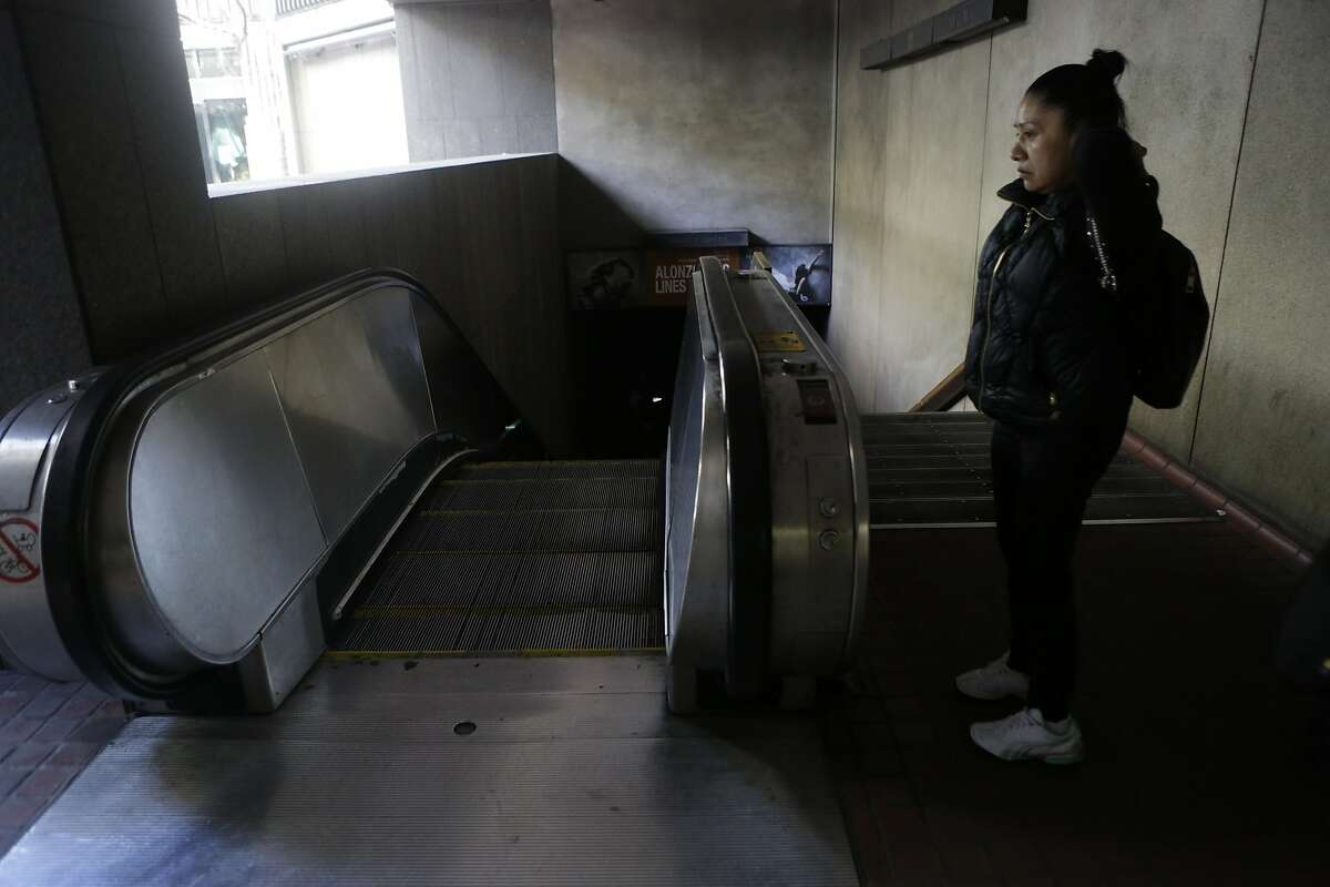 A woman tries to enter Montgomery station before realizing it has been closed down to a power outage on Friday, April 21, 2017, in San Francisco, Calif.