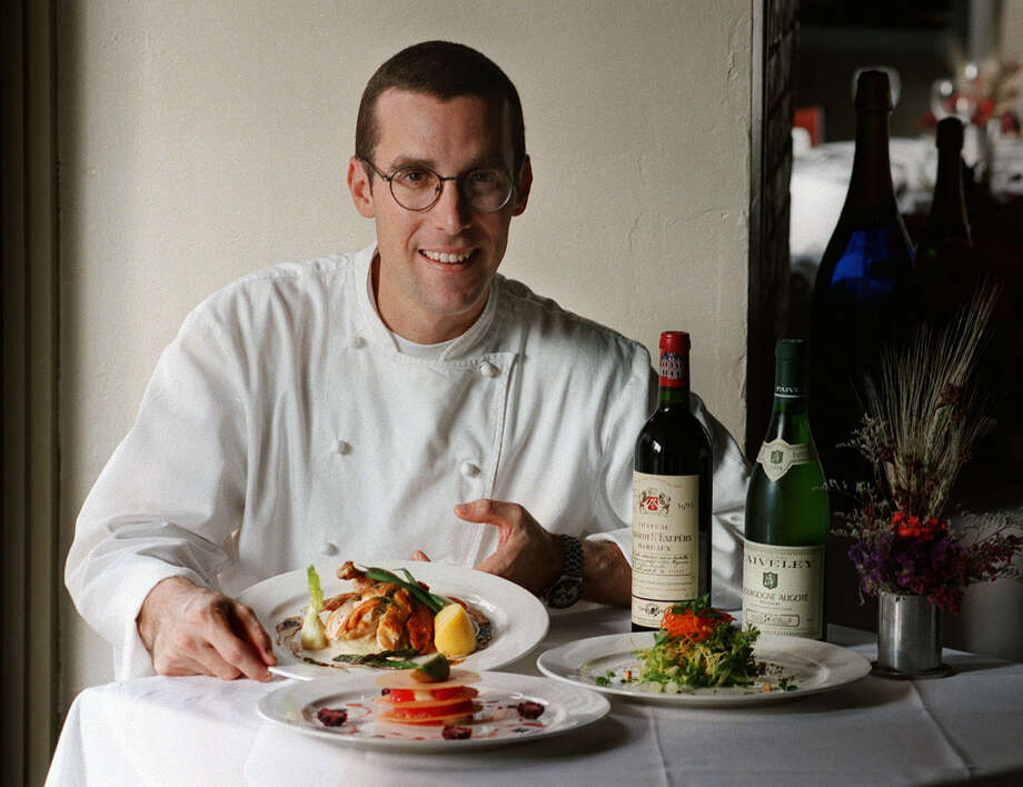 A look back to Le Rêve right after it opened in 1998. Restuarant Chef Andrew Weissman poses at the restaurant with Brasserie Style Roast Chicken, Citrus Napoleon, foreground left, and Salade Francaise, right. Weissman is bringing back Le Rêve for one night as a fundraiser for the McNay Art Museum. / TXSAE