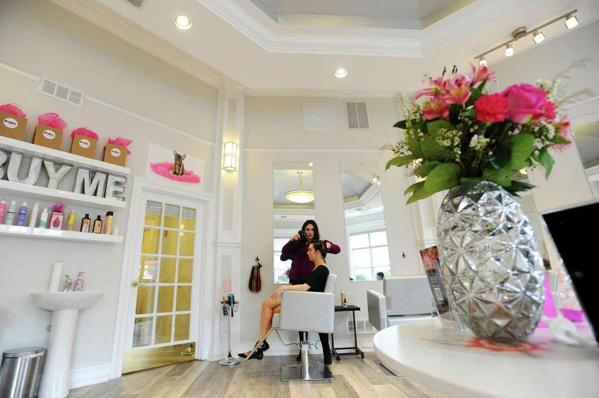 Potential hair stylist Amaris Pichardo blow-dries Gabrielle McGrath's hair inside Pink Soda hair salon in downtown Stamford, Conn. on Wednesday, April 19, 2017.
