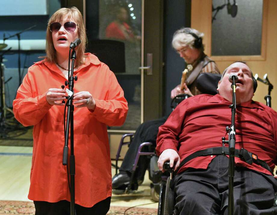 Vocalists Adrienne Phillips, left, and Scott Stuart in the Schenectady County Community College's School of Music Recording Studio as the band Flame records their new CD Friday April 21, 2017 in Schenectady, NY. Flame is a 10-piece Gloversville-based band comprising talented musicians who also happen to have disabilities.  (John Carl D'Annibale / Times Union) Photo: John Carl D'Annibale / 20040304A
