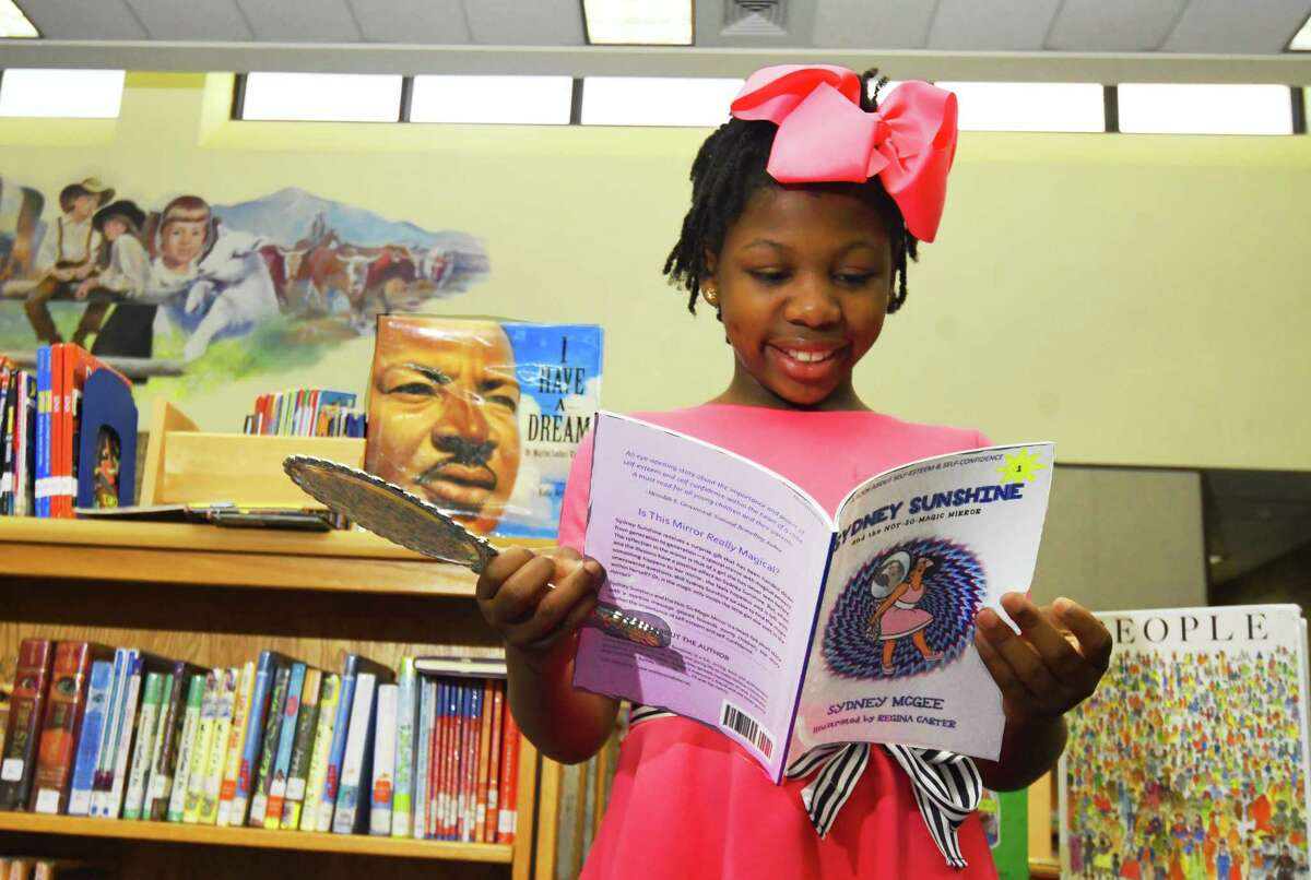 """Sydney McGee, a student at Wilson Elementary School, is the author of the recently released best-selling children's book """"Sydney Sunshine and the Not-So-Magic Mirror."""""""