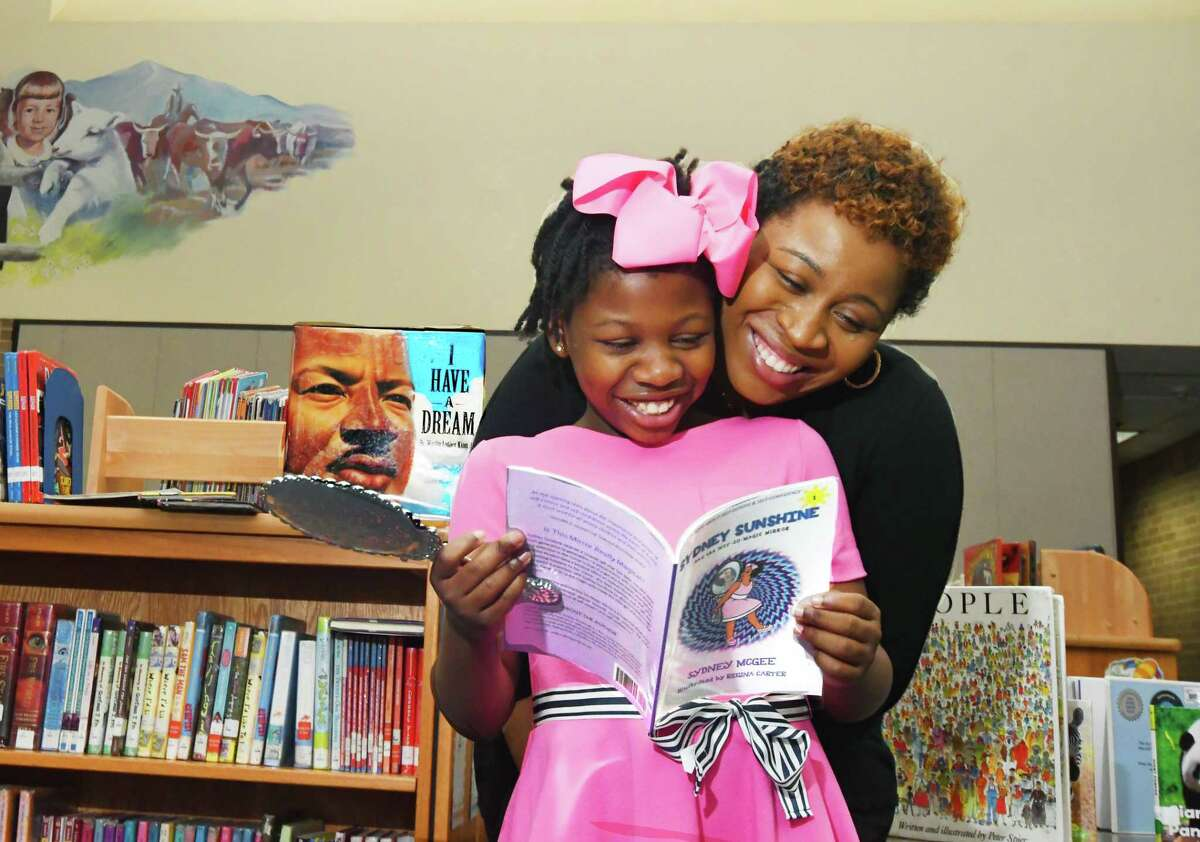 """Sydney McGee, a student at Wilson Elementary School, is the author of the recently released best-selling children's book """"Sydney Sunshine and the Not-So-Magic Mirror."""" McGee's mother, Meredith E. Greenwood, is also a published author."""
