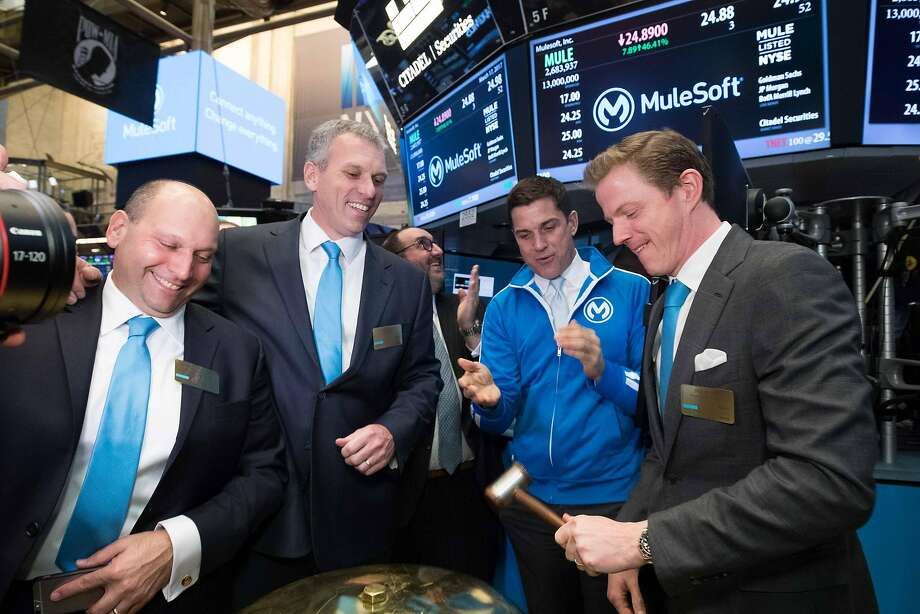 On Friday, March 17th, executives and guests of MuleSoft, Inc. (NYSE:MULE) visit the New York Stock Exchange (NYSE) to celebrate their IPO. To mark the occasion Chairman & Chief Executive Officer, Greg Schott, along with Founder, Ross Mason, ring the Opening Bell. Pictured from left to Right: Simon Parmett (President, Field Operations), CEO Greg Schott, NYSE President Tom Farley and Founder Ross Mason. Photo: NYSE