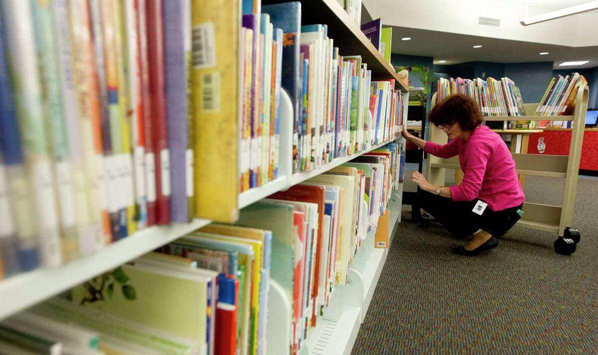 Natalia Martakova reshelves books at the George and Cynthia Woods Mitchell Library, Wednesday, April 20, 2017, in The Woodlands. The library is a finalist for the 2017 National Medal for Museum and Library Service by the Institute for Museum and Library Services. The award is the nationé?•s highest honor given to museums and libraries for service to the community. The branch is one of only 15 libraries selected as finalists for the award this year, and is the only Texas institution to be honored in 2017.