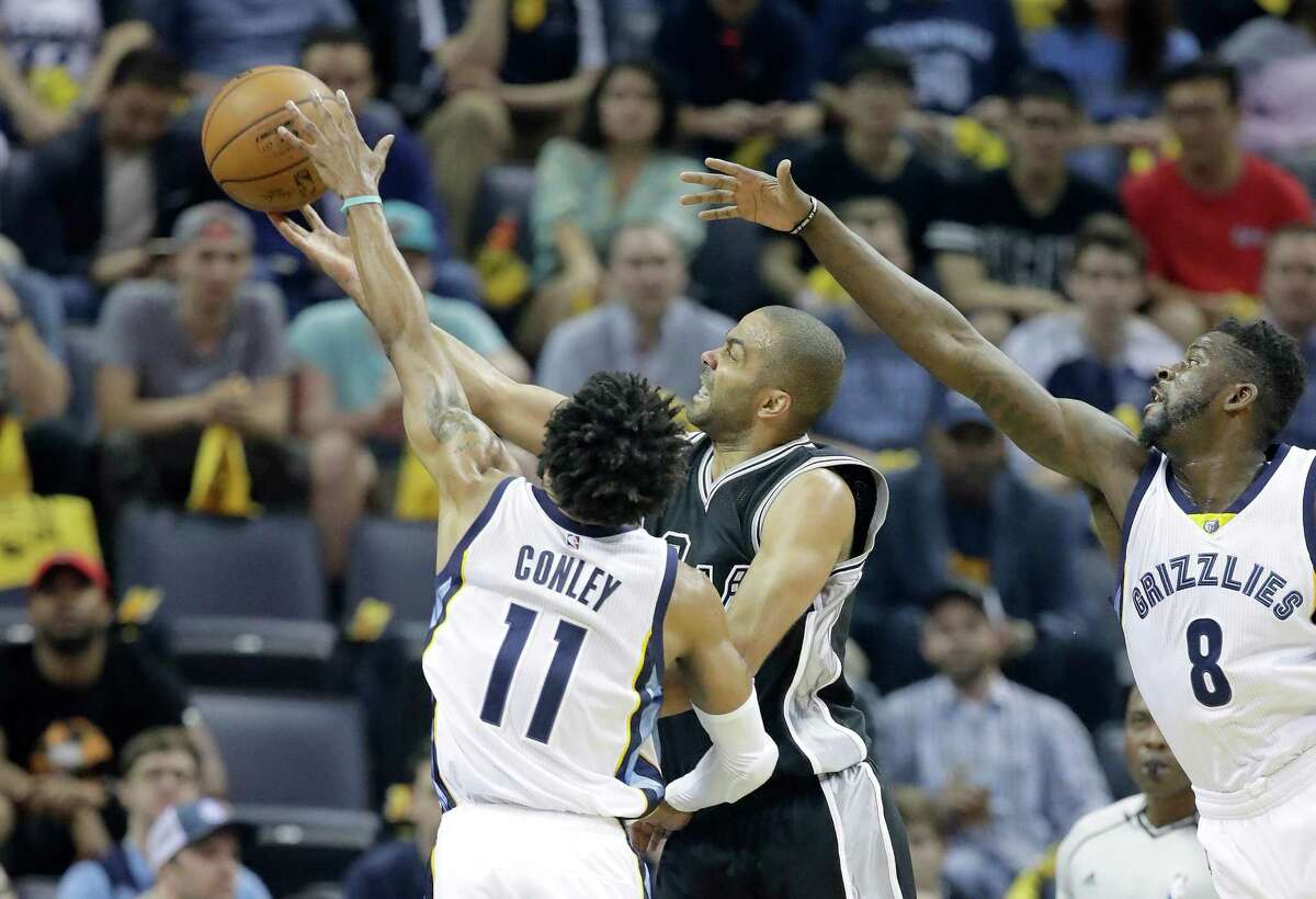 Tony Parker of the Spurs shoots over Mike Conley of the Grizzlies in Game 3 at FedExForum on April 20, 2017 in Memphis, Tenn.