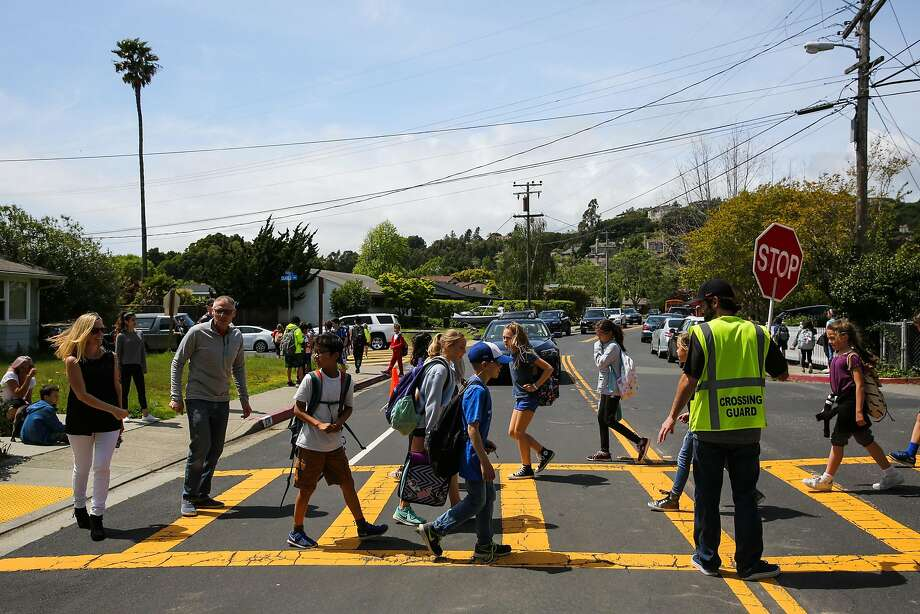 Rhett Krawitt, 9, (center) walks with other students to his car as he goes from school to sailing practice in Tiburon, California, on Wednesday, April 19, 2017. Rhett cannot be vaccinated because he is immune compromised due to having leukemia as a child. Photo: Gabrielle Lurie, The Chronicle