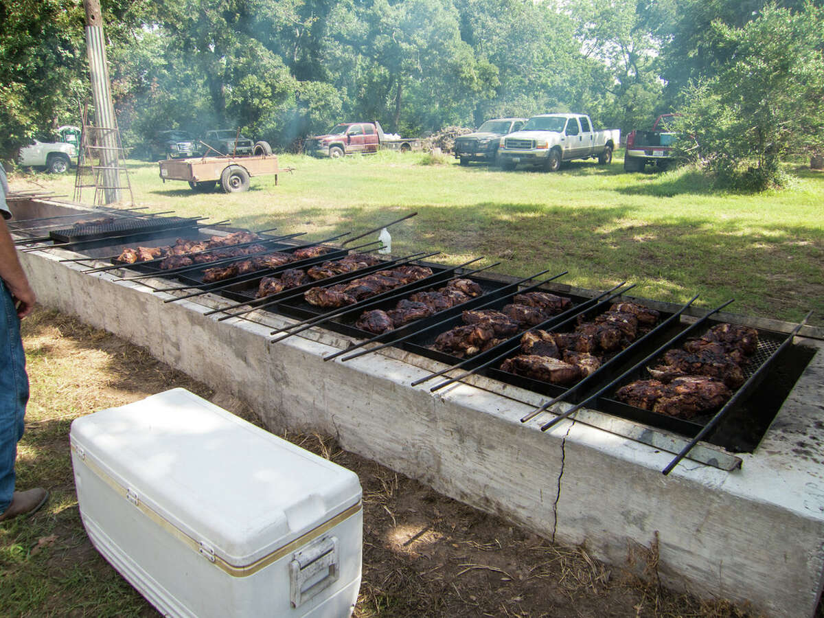 Top: Felix Powell and Wayne Lemon still use a classic brick pit at Powell Bar-B-Q. Trench-style pits were used before offset brick pits.