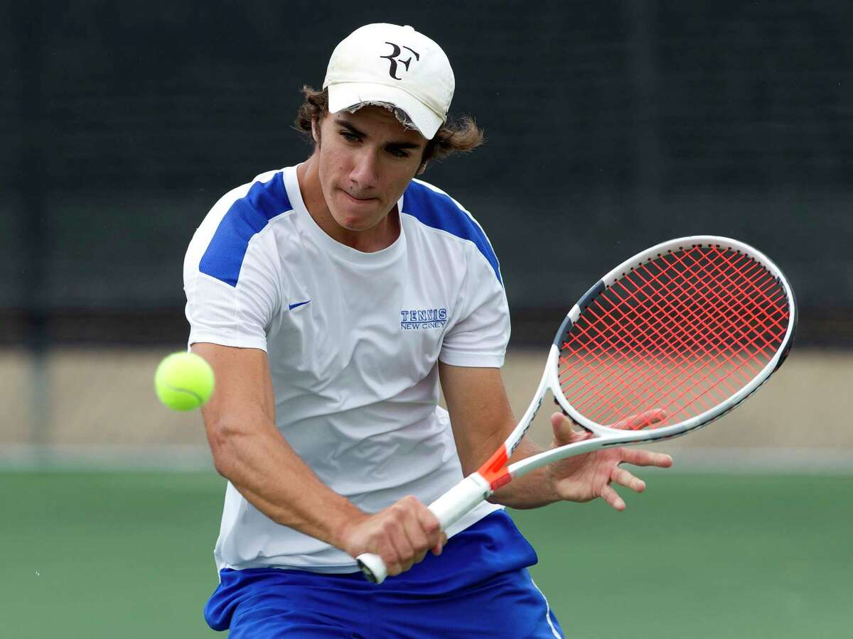 James Duke of New Caney returns a hit during a boys singles match against Ali Hamza of PNG at the Region III-5A tennis tournament at Blythe Calfee Tennis Center, Tuesday, April 18, 2017, in Willis.