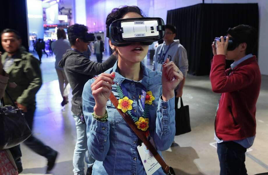 Fatima Saldivar Alcalde of Talent House Inc. tries out the Facebook 360 Surround VR headset at the F8 Facebook Developer Conference in San Jose. Photo: Michael Macor, The Chronicle