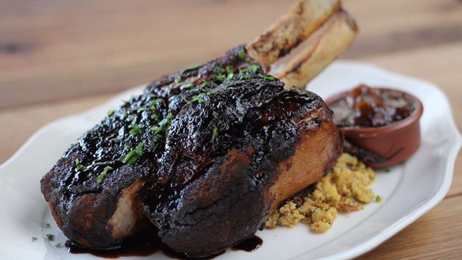 the Red Eye Pork Chop, a gargantuan 24 ounces of chargrilled goodness from Ritual in The Heights.