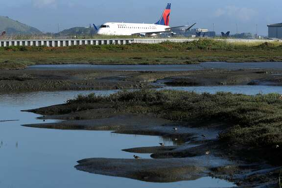 The runways and taxiways at San Francisco International airport are at risk from the coming sea level rise due to climate change, as seen on Wed. April 19, 2017, in San Francisco, Calif.