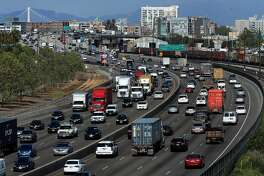 Traffic moves along highway 880 through downtown Oakland, Ca. on Wed. April 19, 2017.
