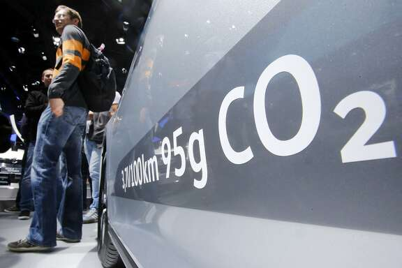 FILE - In this Sept. 22, 2015, file photo, the amount of carbon dioxide emissions is written on a Volkswagen Passat Diesel at the Frankfurt Car Show in Frankfurt, Germany. On Friday, April 21, 2017, a judge ordered Volkswagen to pay a $2.8 billion criminal penalty in the United States for cheating on diesel emissions tests, blessing a deal negotiated by the government for a �massive fraud� orchestrated by the German automaker. (AP Photo/Michael Probst, File)