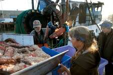 The crew of the fishing vessel Pioneer unloads a catch of petrale sole and bocaccio rockfish at Pier 47 in San Francisco, Calif. on Thursday, April 20, 2017. Joe Pennisi, owner of Pioneer Seafoods, has obtained a permit to sell to restaurants and fish companies right off his boat and eventually to the public.