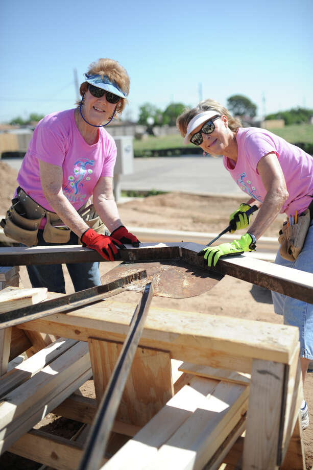 From left, Rita Ehler and Nancy Moreland volunteer with Habitat For Humanity and Meals on Wheels.  The two are photographed April 21, 2017, helping build a Habitat home in south Midland.  James Durbin/Reporter-Telegram Photo: James Durbin