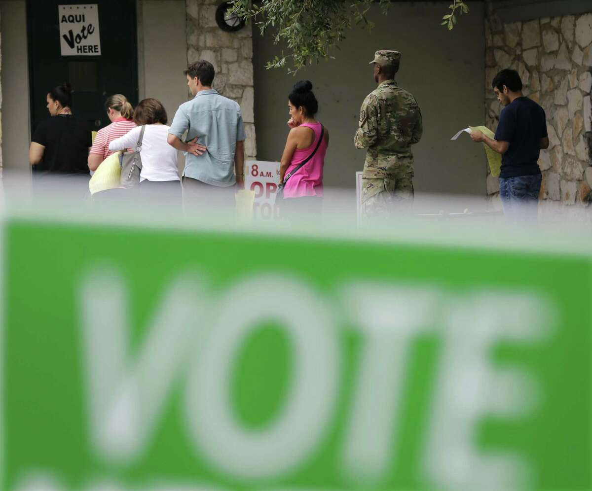 Voters wait in line to cast ballots at an early polling site on Nov. 4 in San Antonio. Bexar County is a model for election best practices.