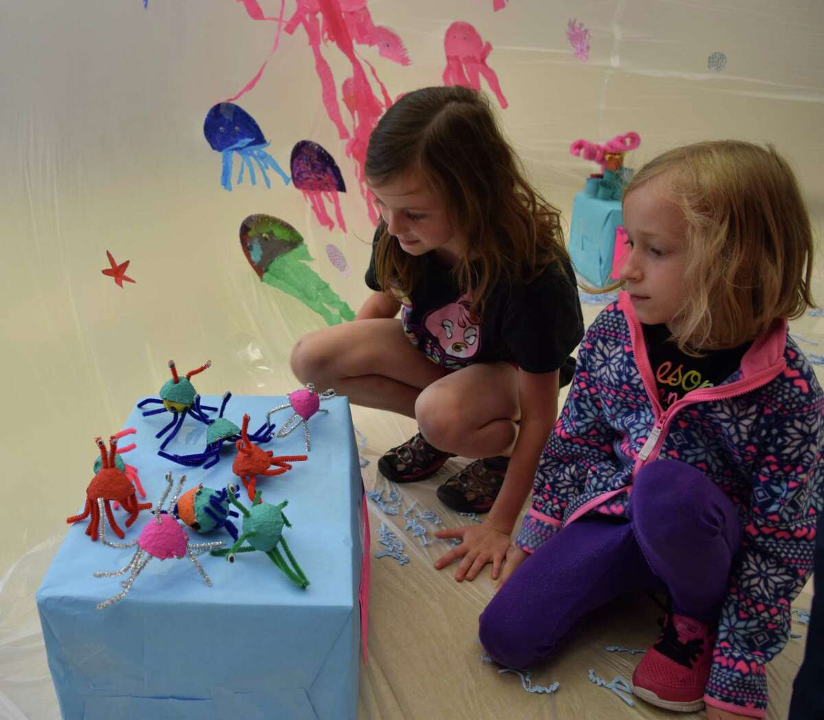 Students enjoy the coral reef display created by Piney Woods Elementary School first-graders.