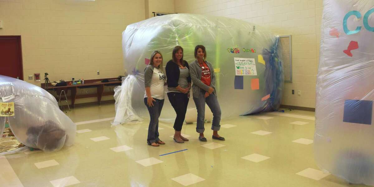 Teachers display students' work at Piney Woods Elementary. First-graders created bubbles depicting different environments.