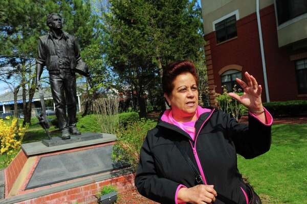 Iris Harrison, who lived across the street at the Sanford Apartments, talks about what she remembers about the L'Ambiance Plaza disaster which occurred 30 years ago this coming Sunday, in front of the memorial statue at the Renaissance Plaza Apartments on Washington Ave in Bridgeport, Conn., on Wednesday Apr. 19, 2017. Jones is one of the first people to become a resident at the apartment complex built after the disaster. At the Washington Avenue accident site, a seven-foot statue of a construction worker, honors the 28 workers killed, and the 22 injured, when the L'Ambiance Plaza building collapsed halfway through construction on April 23, 1987.