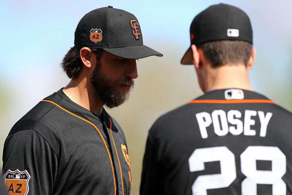 SCOTTSDALE, AZ - FEBRUARY 20:  Madison Bumgarner #40 speaks with Buster Posey #28 of the San Francisco Giants during a workout on Monday, February 20, 2017 at Scottsdale Stadium in Scottsdale, Arizona.  (Photo by Alex Trautwig/MLB Photos via Getty Images)