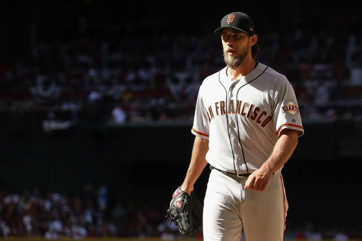 PHOENIX, AZ - APRIL 02: Starting pitcher Madison Bumgarner #40 of the San Francisco Giants walks off the mound during the MLB opening day game against the Arizona Diamondbacks at Chase Field on April 2, 2017 in Phoenix, Arizona. (Photo by Christian Petersen/Getty Images)
