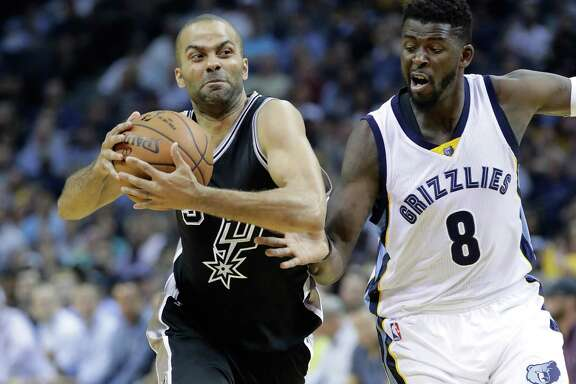 Tony Parker of the Spurs tries to drive around James Ennis III of the Grizzlies in Game 3 at FedExForum on April 20, 2017 in Memphis, Tenn.