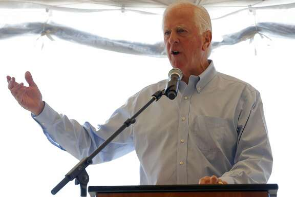 United States Rep. Mike Thompson, D-Calif., speaks to a crowd to celebrate the levee breach near Sonoma, California, on Sunday, Oct. 25, 2015.