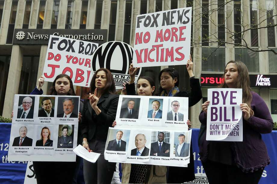 Sonia Ossorio, second left, president of the National Organization for Women New York, speaks outside the News Corporation headquarters, in New York, Thursday, April 20, 2017, a day after Fox News Channel's Bill O'Reilly was fired. The firing came on the heels of a New York Times report on April 1, that five women had been paid a total of $13 million to keep quiet about their disturbing encounters with O'Reilly. (AP Photo/Richard Drew) Photo: Richard Drew, Associated Press