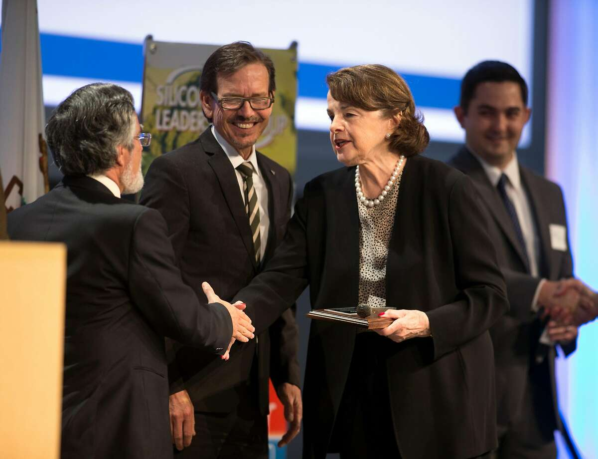U.S. Sen. Dianne Feinstein, right, greets Aaron Peskin, chairman of SFCTA, left, and Robert Raburn, board vice president of BART, before speaking to an audience at the Silicon Valley Leadership Group on Friday, April 21, 2017 in Sunnyvale, Calif.