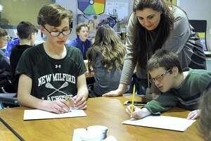 Art teacher Layla Kateurji, of Lebanon, visiting Schaghticoke Middle School, helps Josh Berkun draw 3-D objects in art class Thursday, April 20, 2017. Left is Quinn Danvers working on the same assignment.