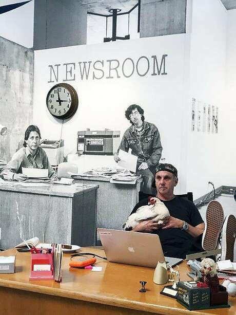 Jim Goldberg holding Editor in Fake Newsroom project Photo: Photo By Daniela Hichak, With Permission To The Chronicle