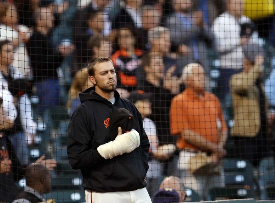 San Francisco Giants pitcher Jeremy Affeldt with a bandaged right hand watches opening ceremonies prior to the start of the Giants game with the San Diego Padres at AT&T Park on Tuesday September 13, 2011 in San Francisco, California. Photo: Lance Iversen, The Chronicle