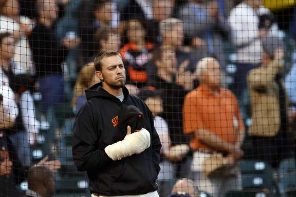 San Francisco Giants pitcher Jeremy Affeldt with a bandaged right hand watches opening ceremonies prior to the start of the Giants game with the San Diego Padres at AT&T Park on Tuesday September 13, 2011 in San Francisco, California.