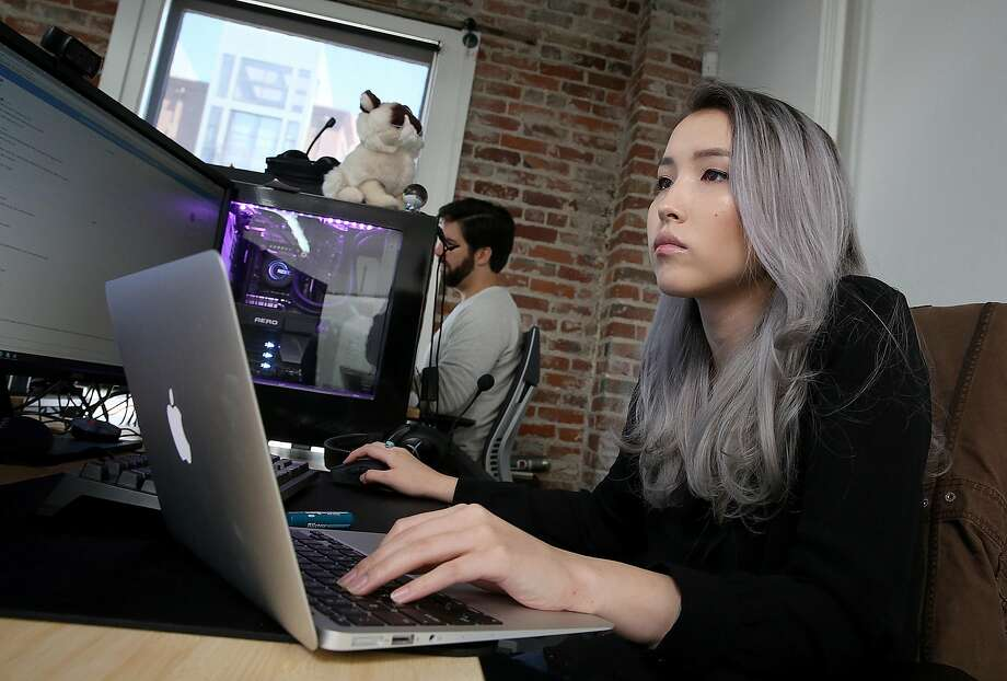 Operations manager Jennie Pasinsky works at Forge, which makes a plug-in that users can run in the background of a game. Photo: Liz Hafalia, The Chronicle
