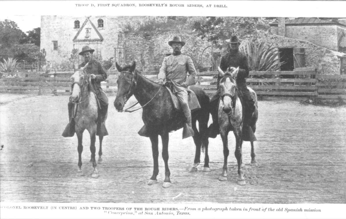 Theodore Roosevelt and two of his Rough Riders on horses in front of Mission Concepción in San Antonio, circa 1898.