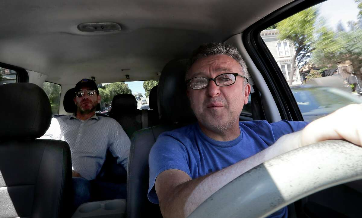 Bobby Soltanian a Flywheel taxi driver since 1995 takes his passenger Conor Nugent, who only uses Flywheel, to his destination in San Francisco, Calif., on Fri. April 21, 2017.