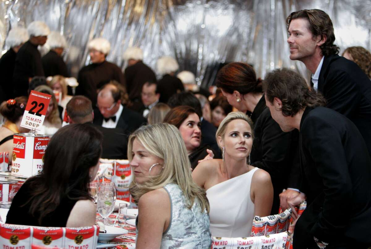Summer Tompkins Walker (blonde in profile in foreground) and behind her, Vanessa Getty (one-shouldered white gown) chats with Metallica drummer Lars Ulrich as her husband Billy Getty (looking over the table) SFMOMA's Modern Ball 2007 with three parties in one and an auction fundraiser Wednesday May 1, 2007.