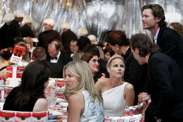 Summer Tompkins Walker (blonde in profile in foreground) and behind her, Vanessa Getty (one-shouldered white gown) chats with Metallica drummer Lars Ulrich as her husband Billy Getty (looking over the table) SFMOMA's Modern Ball 2007 with three parties in one and an auction fundraiser Wednesday May 1, 2007.  Kat Wade/The Chronicle