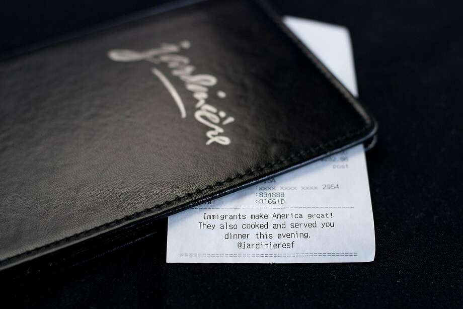 A note supporting immigrant workers lines the bottom of a Jardinière check. Photo: Noah Berger, Special To The Chronicle