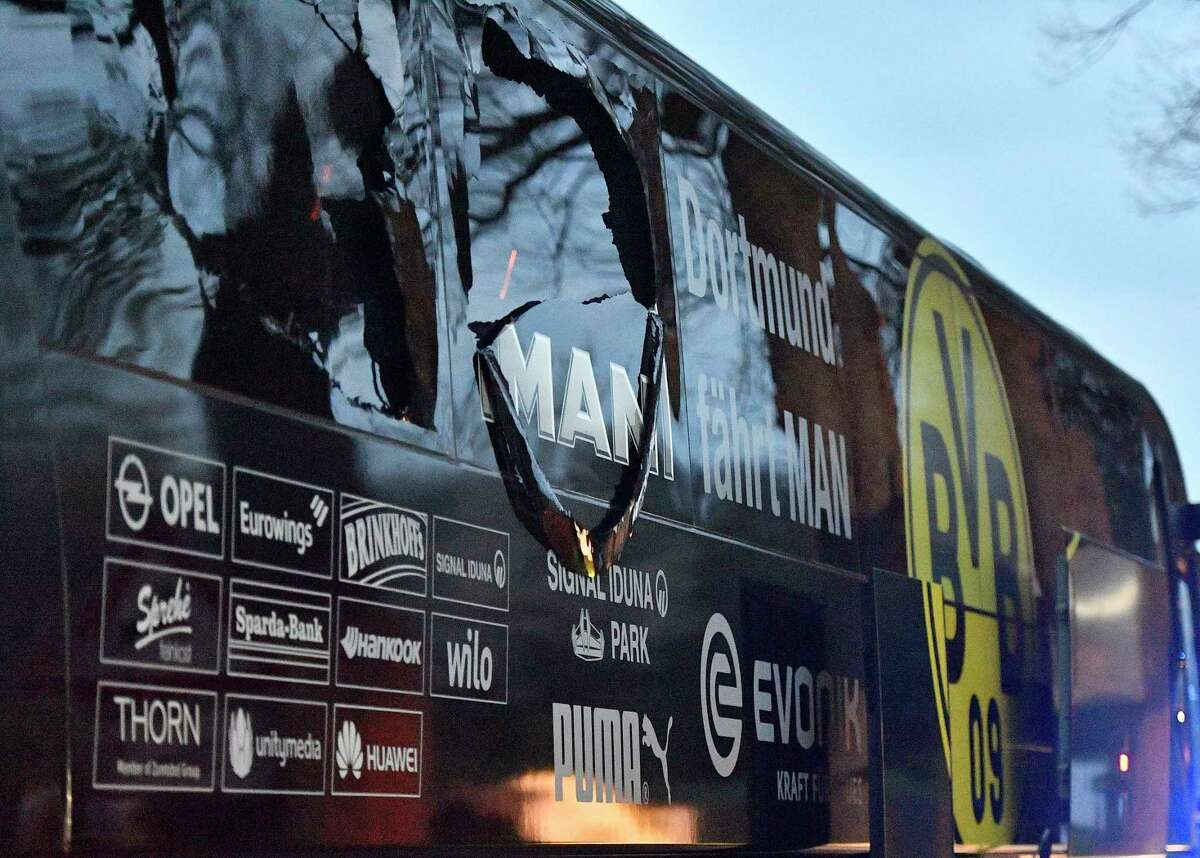 A bombing April 11 shattered windows on the Borussia Dortmund soccer team's bus. Authorities say a suspect tried to disguise the attack as Islamic terrorism.
