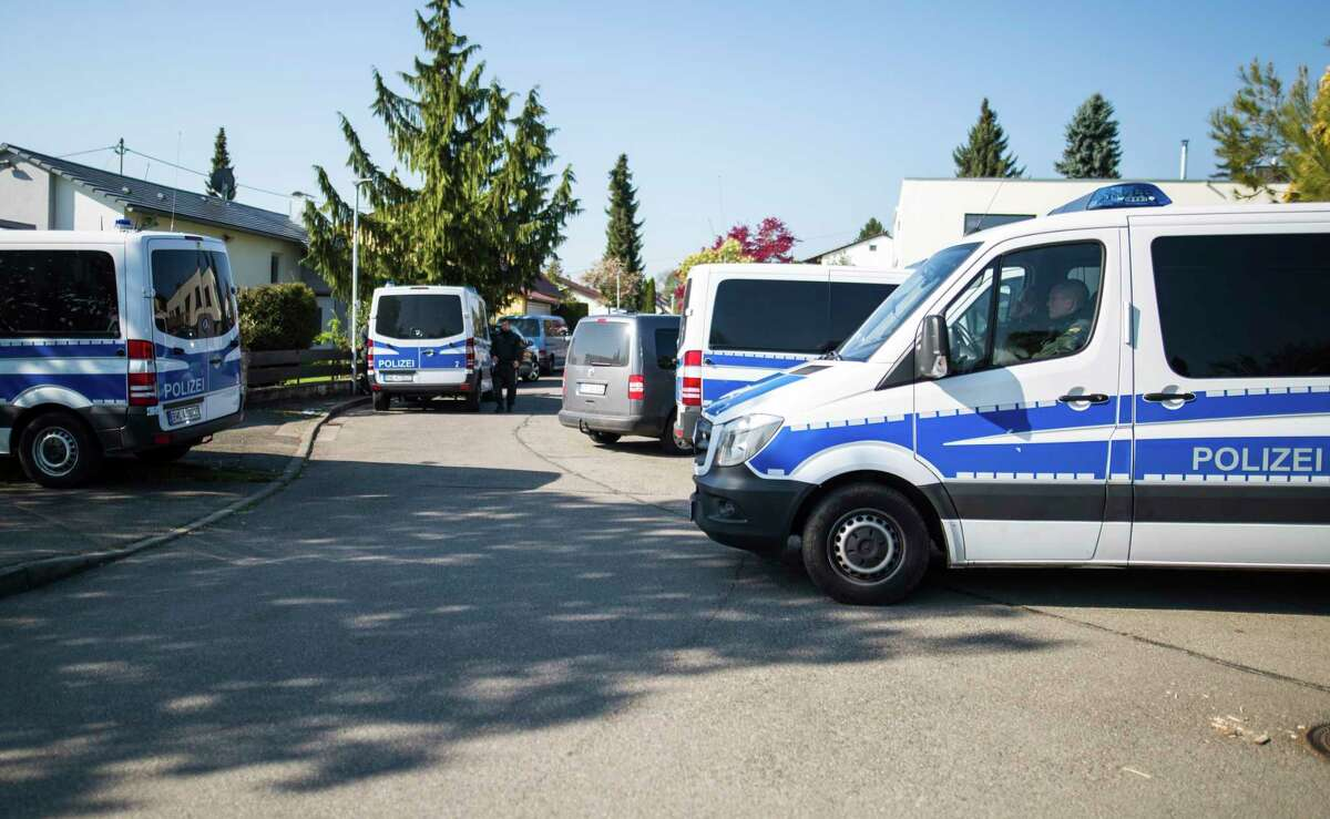 Police vehicles stand in a street in Rottenburg am Neckar, southern Germany, Friday, April 21, 2017 where a suspect was arrested in connection to the explosives attack on the team bus of Borussia Dortmund the week before. (Christoph Schmidt/dpa via AP)