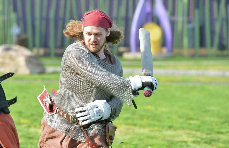"""Administrator Tim Smith, """"Brogar Volant"""" practices with his group Myrmidon, the Connecticut chapter of Dagorhir Battle Games Association. Dagorhir is fast-paced full-contact medieval style combat with padded weapons. The team uses swords, shields, spears, axes, and practices at Matthews park on Thursday April 20, 2017 in Norwalk Conn. Photo: Alex Von Kleydorff / Hearst Connecticut Media / Norwalk Hour"""