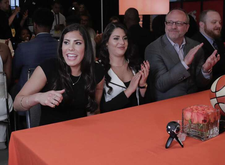 Kelsey Plum (left) reacts after being announced as the No. 1 pick in the WNBA draft by the San Antonio Stars, on April 13, 2017, in New York.