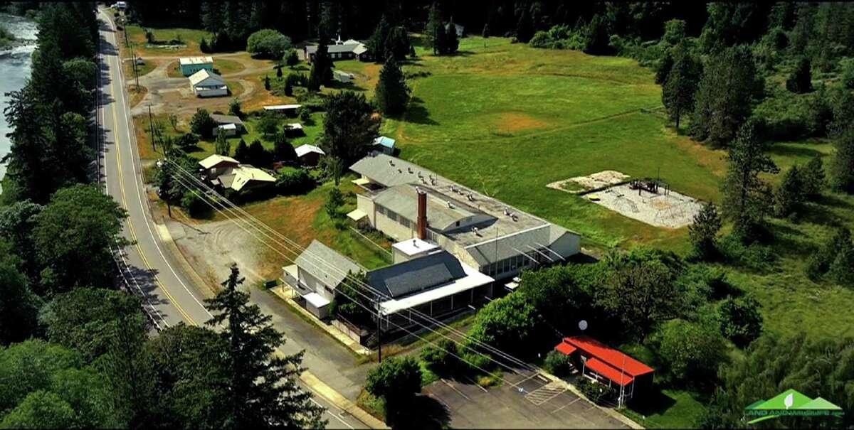This undated aerial photo taken from a drone video shows Tiller, Ore. Almost all of the downtown in Tiller, a dying timber town in remote southwestern Oregon, is for sale for $3.5 million and the elementary school is for sale separately for $350,000. The asking price of $3.5 million brings with it six houses, the shuttered general store and gas station, the land under the post office, undeveloped parcels, water rights and infrastructure that includes sidewalks, fire hydrants and a working power station.