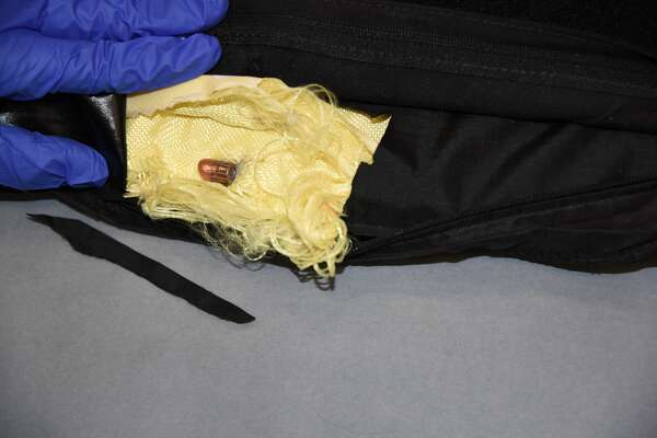 A bullet is shown inside the Armor Express level IIIA vest worn by one of the Seattle Police Department officers shot while responding to a robbery report on April 21, 2017.